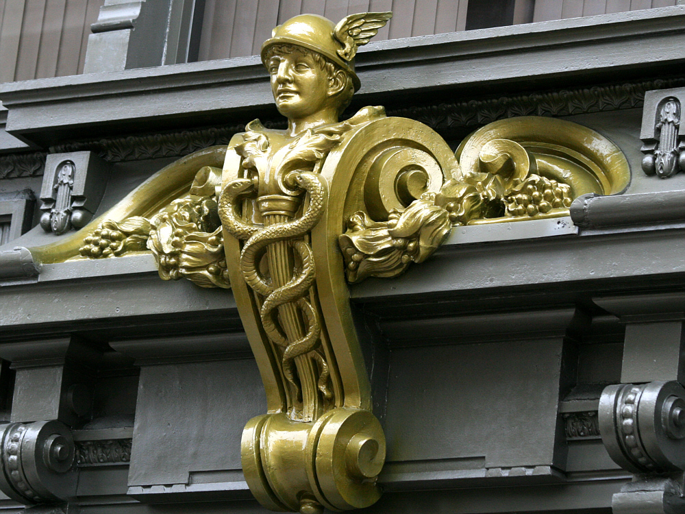 Above the entrance: Mercury, the Winged Messenger.