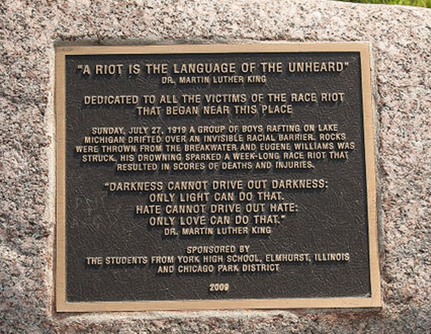 This small plaque is located on a stone and was dedicated in 2000. It is important to note that the selected quote from MLK Jr. was in reference to protests in the 1960s.
