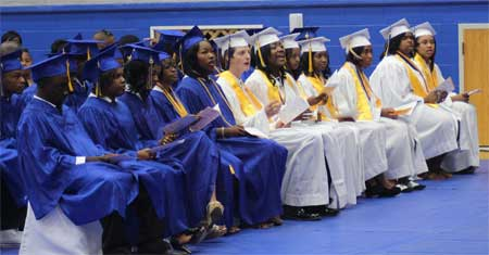 Black and white students from Kemper County High School (formerly Dekalb High School) graduate in 2013