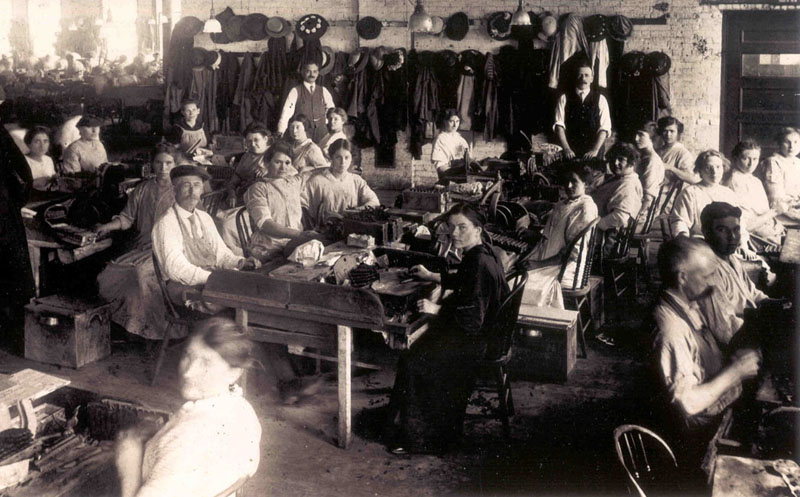 Interior view showing original cigar production workers.