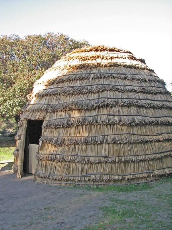 While the fort was being built, Sutter and his workers lived in tule reed houses, perhaps like this Chumash reconstruction at Mission La Purisima in Lompoc. (Flickr. Credit below).
