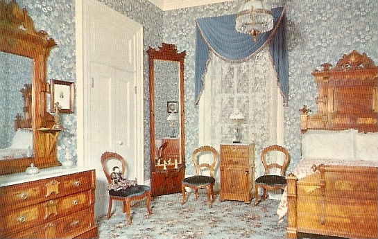 A redecorated room that shows what the inside of the home may have looked like.