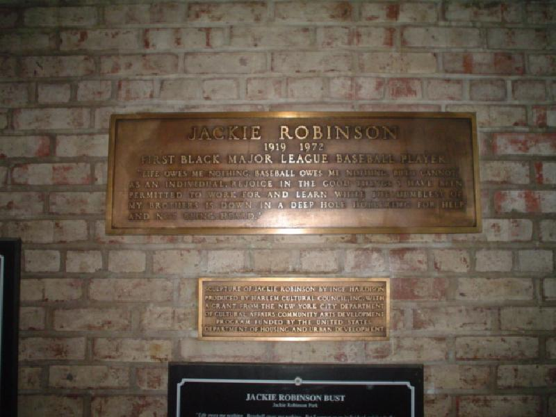 Two plaques can be found near the bust of Robinson and the entrance to the center