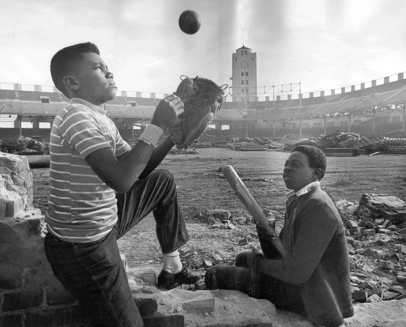 Two boys play during demolition of Wrigley Field in 1969.