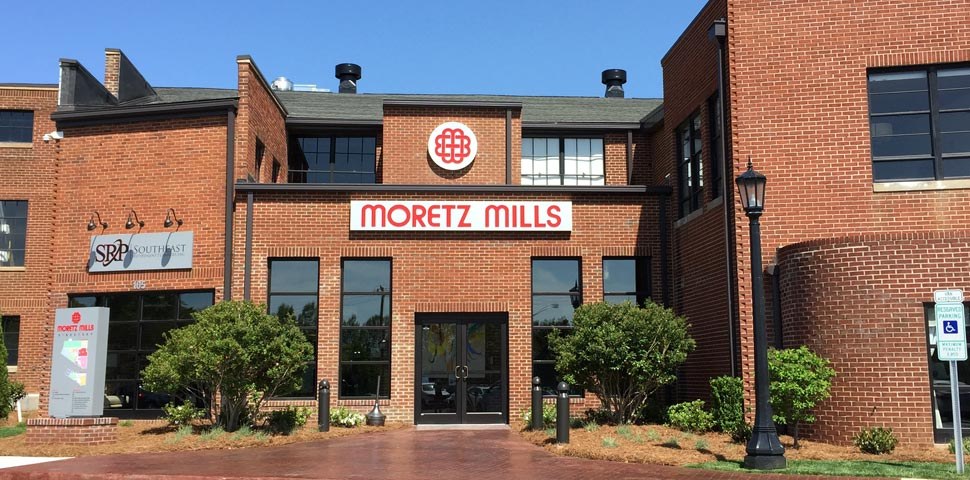 The front of the building with the Moretz Mills logo on display.
