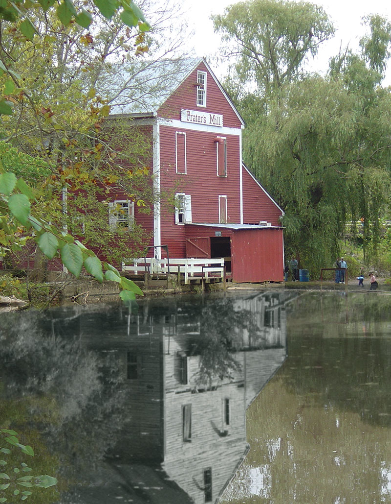 Prater's Mill before (reflection) and after the 42 years of restoration by the Prater's Mill Foundation.