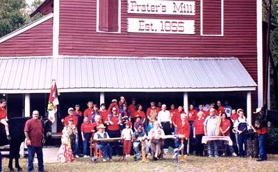 1999: Three millers, Prater's Mill Gang volunteers with mule, on the front porch of the mill, at the turn of the 21st century.