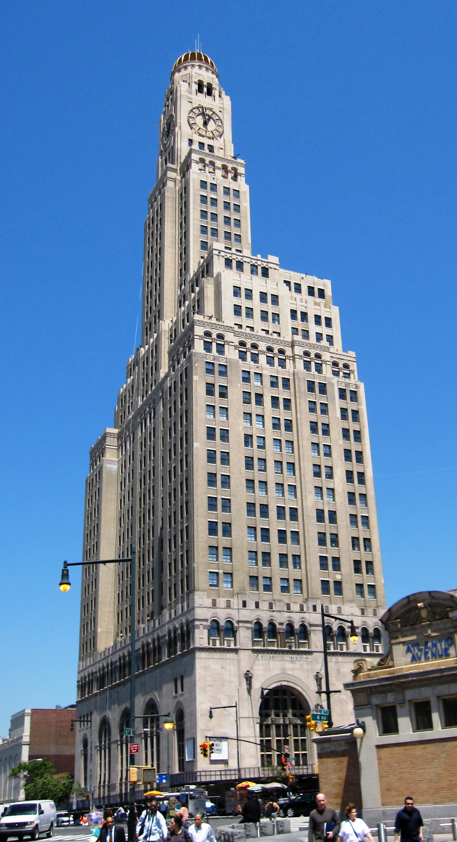 The former bank building is best-known for its clock tower and copper dome.