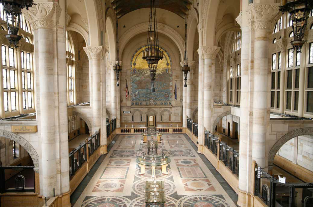 The lobby features stained glass and marble, as well as large arches and murals as well as a sixty-foot ceiling.