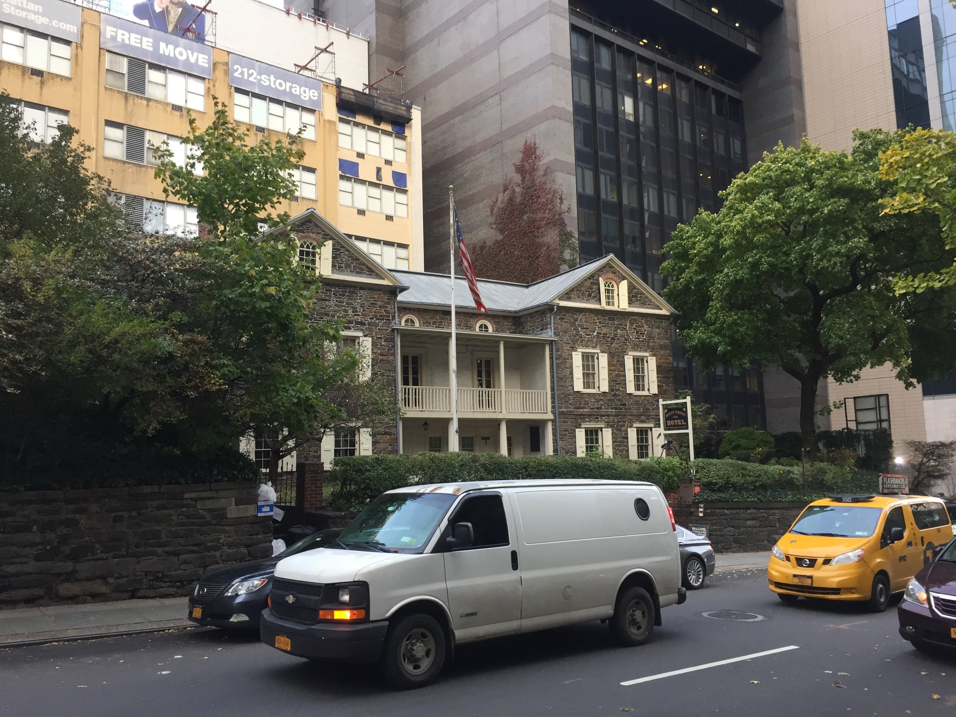 Mount Vernon Hotel Museum and Gardens dwarfed by E 61st St. towers today.