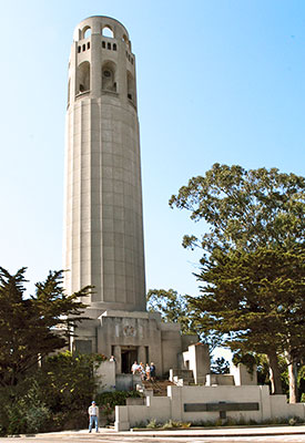 Present-day Coit Tower. A statue of Christopher Columbus in front of the structure was installed in 1957.