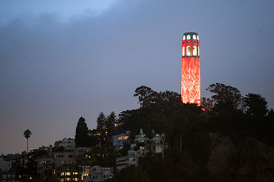 An evening view of the tower, illuminated by modern lighting fixtures. Small infrastructure changes and seismic upgrades have occurred through the decades, but little has changed about the structure itself since 1933.