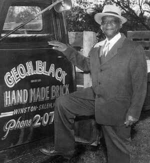 A photograph of George Black and his delivery truck.