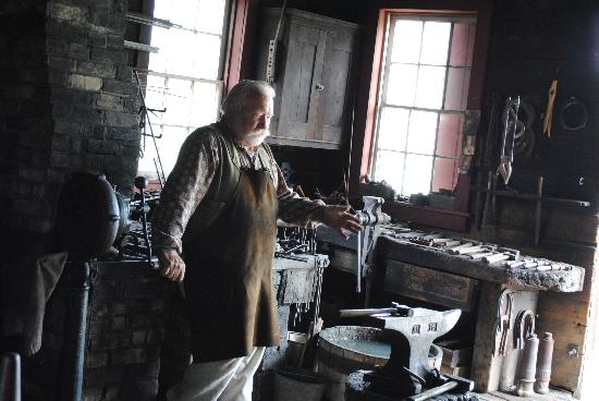 The blacksmith working at the Koepsell House