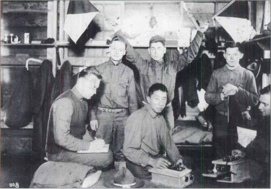 Keitaro Tsukamoto (seated center) served in the U.S. Army in World War I. Despite his service, he was imprisoned along with his family during World War II. Luckily, the People's Laundry was restored to the family in 1946 (San Francisco's Japantown: Arcadi