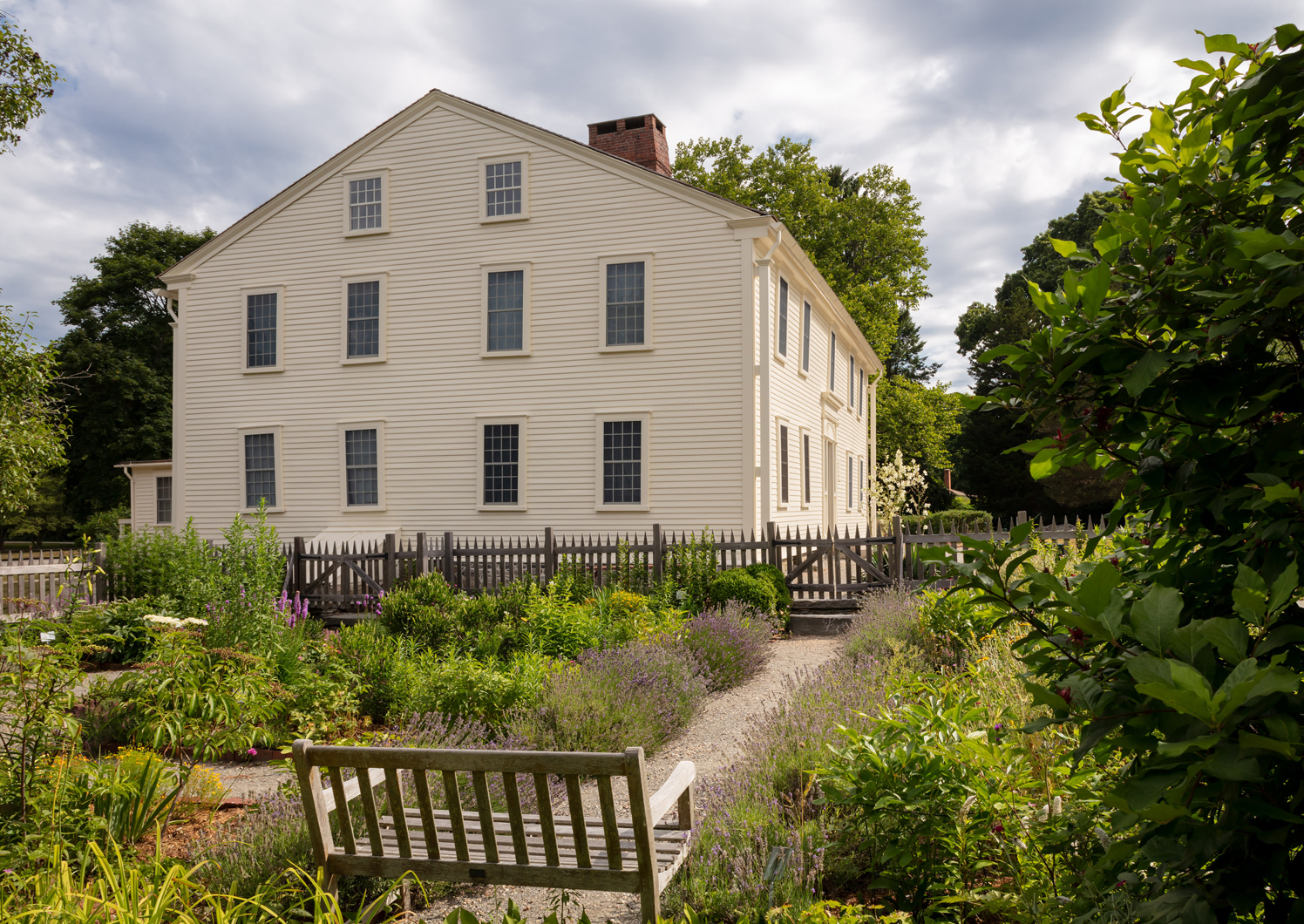 A view of Smith's Castle from the side with a garden in the foreground.