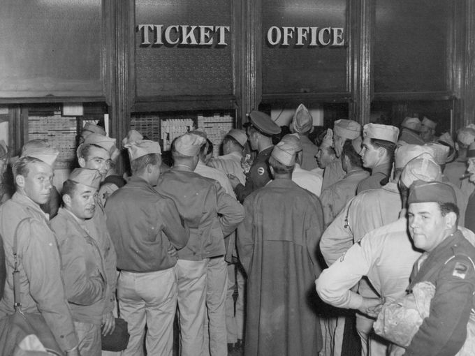 Soldiers on furlough buying tickets at Union Station during WWII