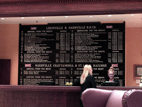 An old Arrivals and Departures board over the lobby desk of the Union Station Hotel