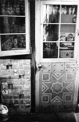 1961 photo of house. Patio looking into kitchen
