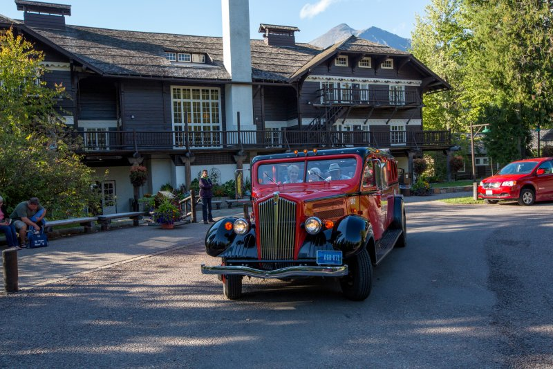 A Red Bus in front of the lodge. Credit: Glacier National Park