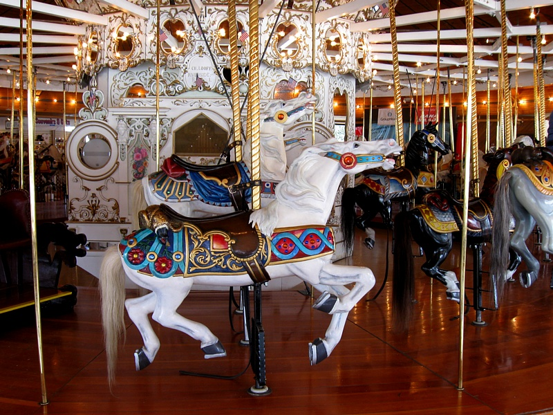 A few of the horses on the carousel. Since they face the public as the carousel turns, the right sides of all of the carvings are more ornate than the left sides.
