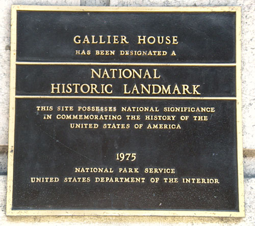 The plaque installed on the outside of the house deeming it a historical landmark.