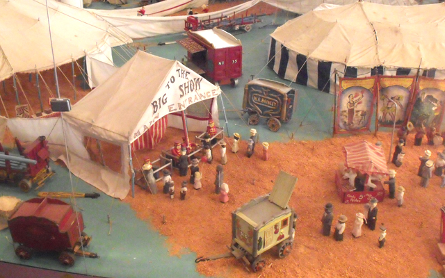 The 1,000 square-foot, 3/4-inch scale model exhibit on the museum's third floor showcases a five-ring circus with over 3,000 hand-carved miniature figures.