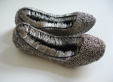 Untitled work showcasing pins and shoes by Erwina Ziomkowska
