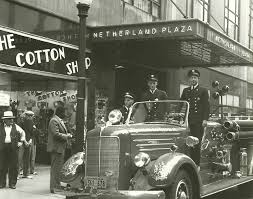 Firefighters pose outside of the Netherland Plaza. The hotel was damaged in a 1942 fire that resulted in the loss of its iconic chandelier.