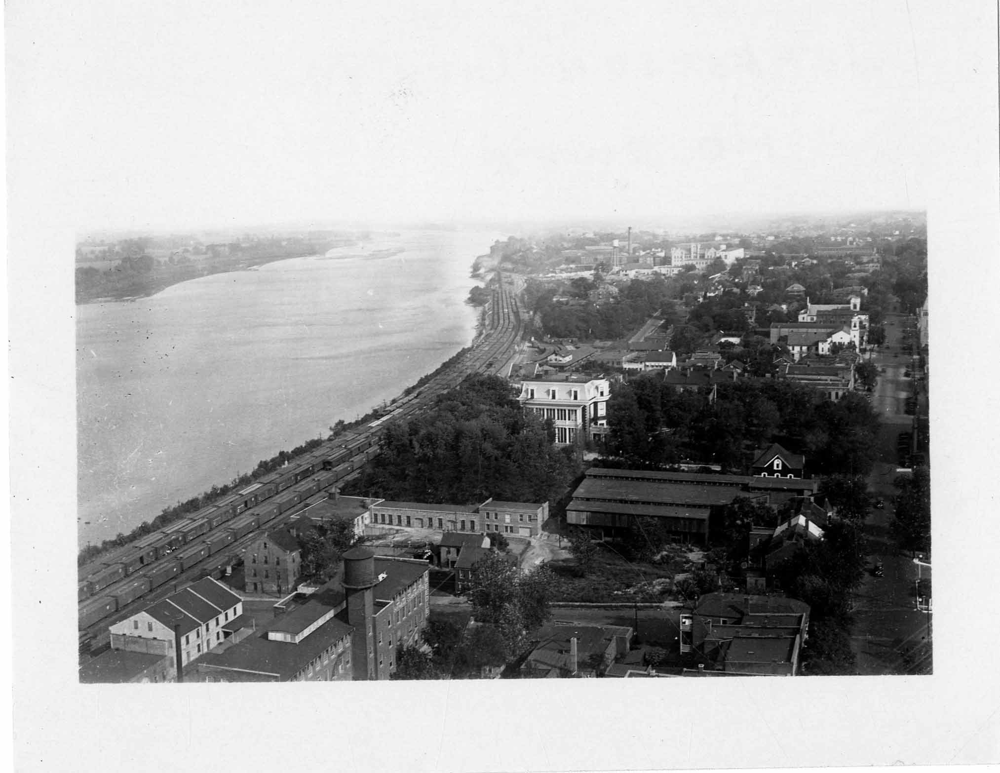 View from Capitol dome looking east showing the area between E. Capitol Ave. and the Missouri River in 1931.  The buildings of Jefferson Landing State Historic Site are visible at the lower left of the image.  Photo courtesy Missouri State Museum.