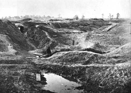 Picture of the Crater. Union soldiers are inside the crater after capturing the city of Petersburg. 1865.