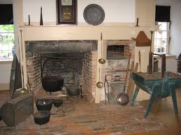 An image from of a restored fireplace scene from inside the Museum.
