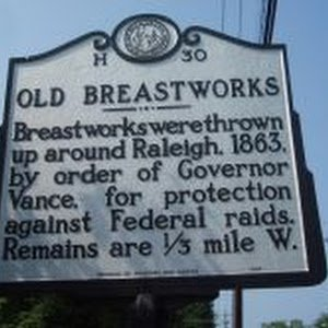 The remains of the defensive breastworks are about a third of a mile west from this marker.