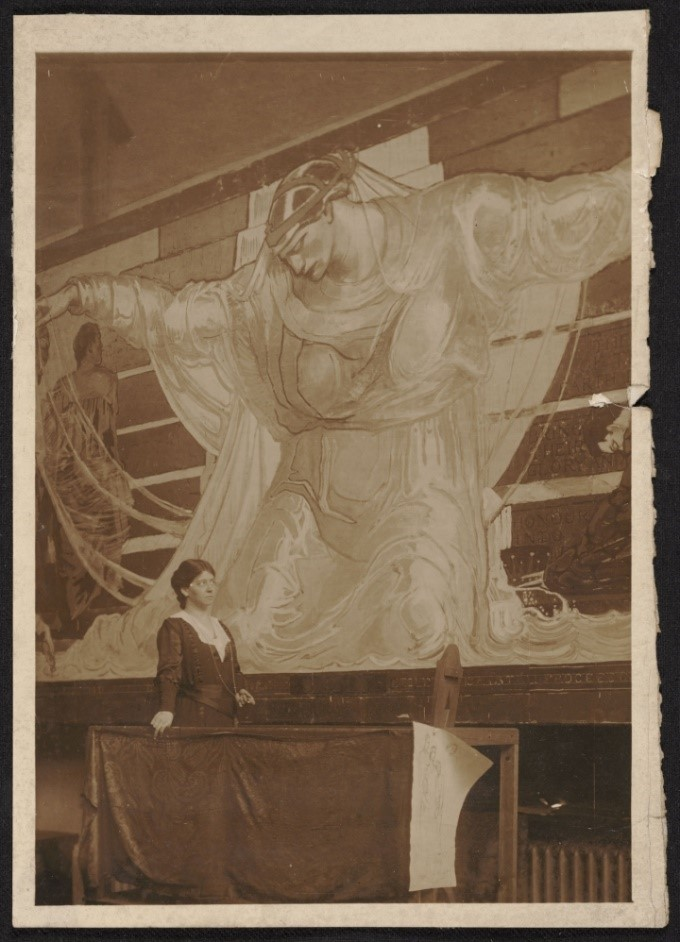 """Oakley with her mural, """"International Unity and Understanding,"""" which stretches 44 feet wide"""