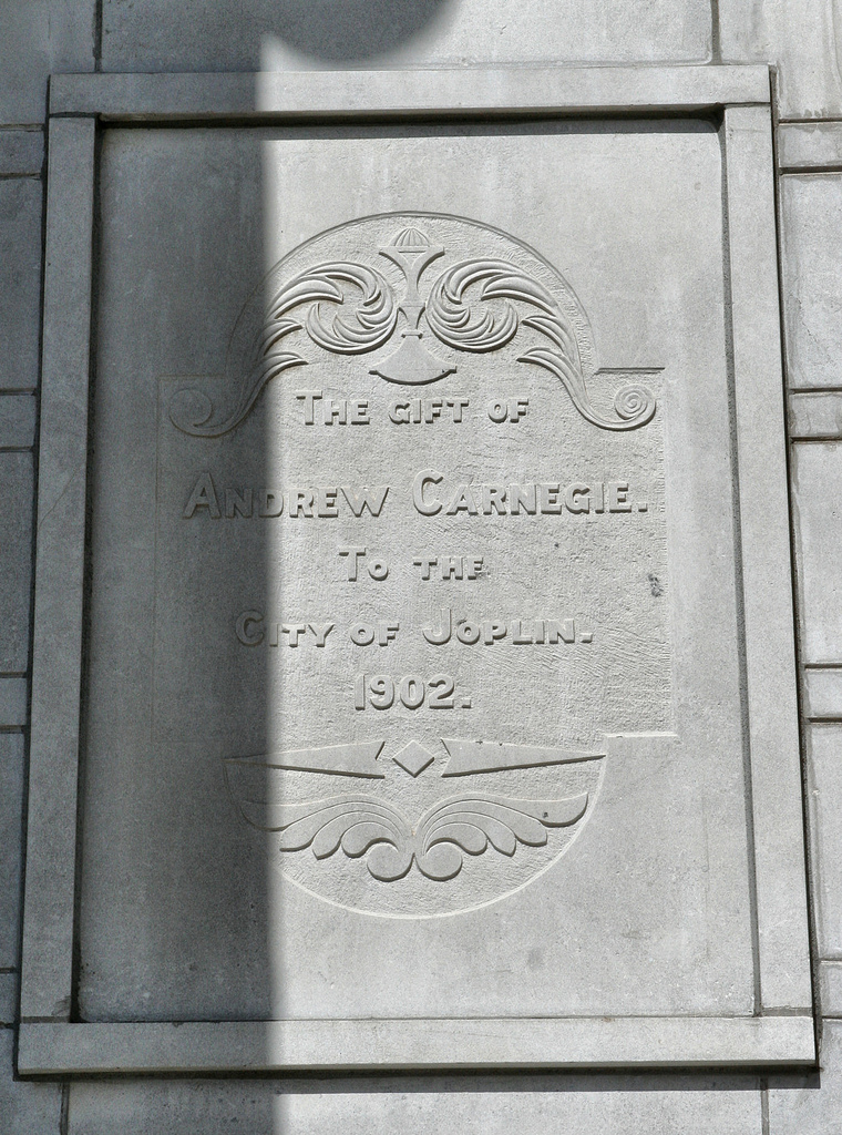 The plaque commemorating the gift from Andrew Carnegie located next to the building's entrance