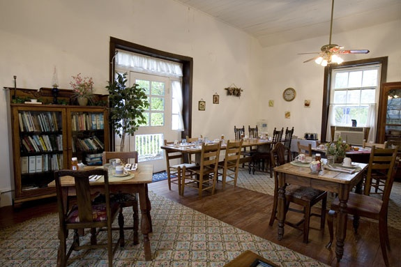 Guests have breakfast in the parlor of the 1861 Vance house