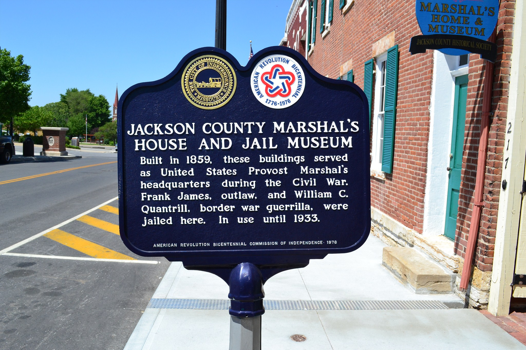 Closeup of the historical marker in front of the building.