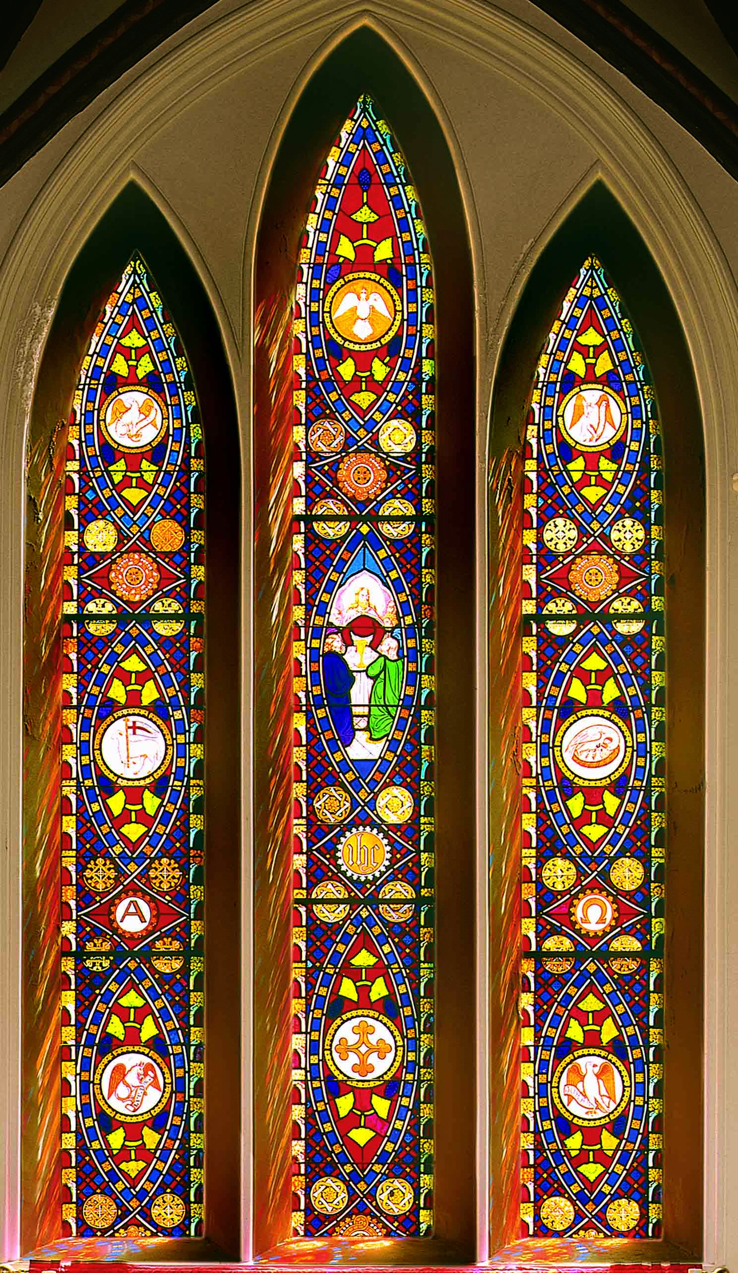 Stained glass window by John Bolton behind the altar at St. Mary's Episcopal Church.