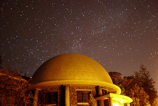 The Lowell Observatory rotunda under a night sky