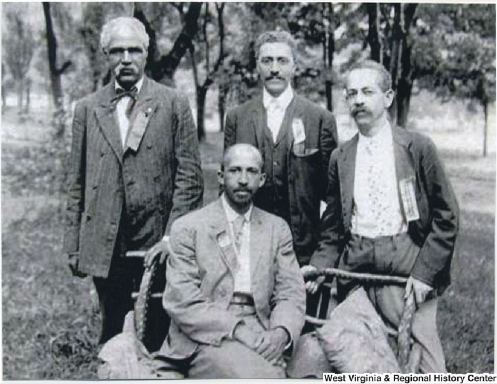 John R. Clifford, standing top left, L. M. Hershaw, standing center, F. H. M. Murray standing to the right, and W. E. B. DuBois seated in center. Photograph taken in 1906 at the Niagara Movement's Second Annual Meeting. Photo courtesy of West Virginia & R