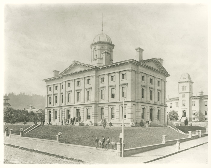 This historic image of Pioneer Courthouse shows the former public school, which also featured the Italianate style of architecture.