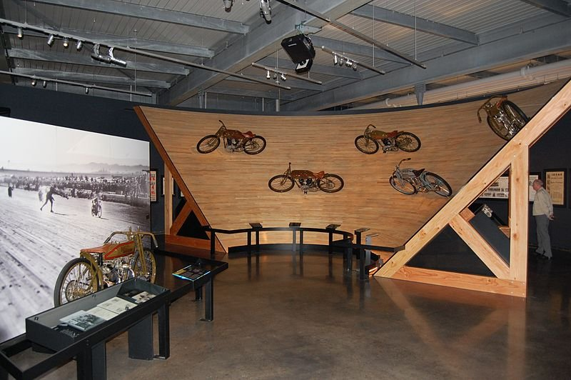 This exhibit of motorcycles racing along a banked wooden track is located in the museum's Clubs and Competition gallery.