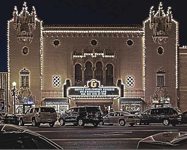 The Granada Theatre lights up at night, adding some beauty to the commercial area.