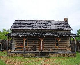 This was added to the fort in 1997 being a 1840 hewed log house and was build out side of the fort itself. reconstructed outside the Fort.