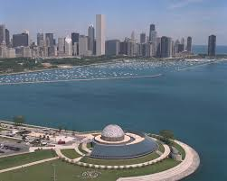 Aerial view of Adler Planetarium with the Chicago skyline as the backdrop