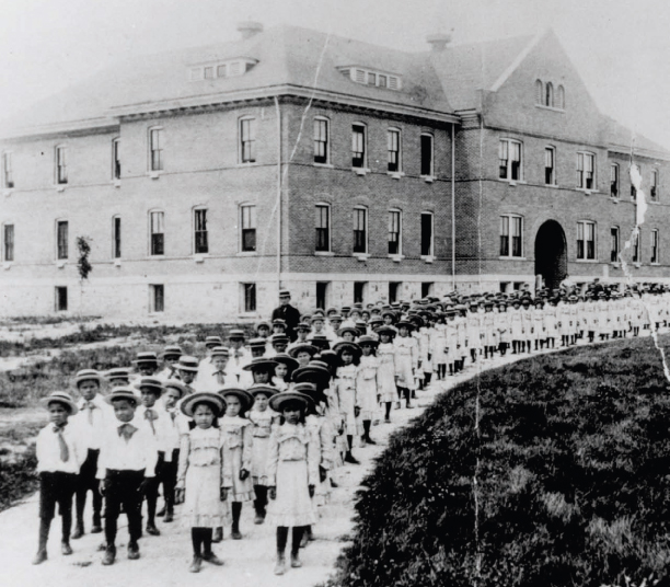 Children line up at the Mt. Pleasant Indian Industrial Boarding School.