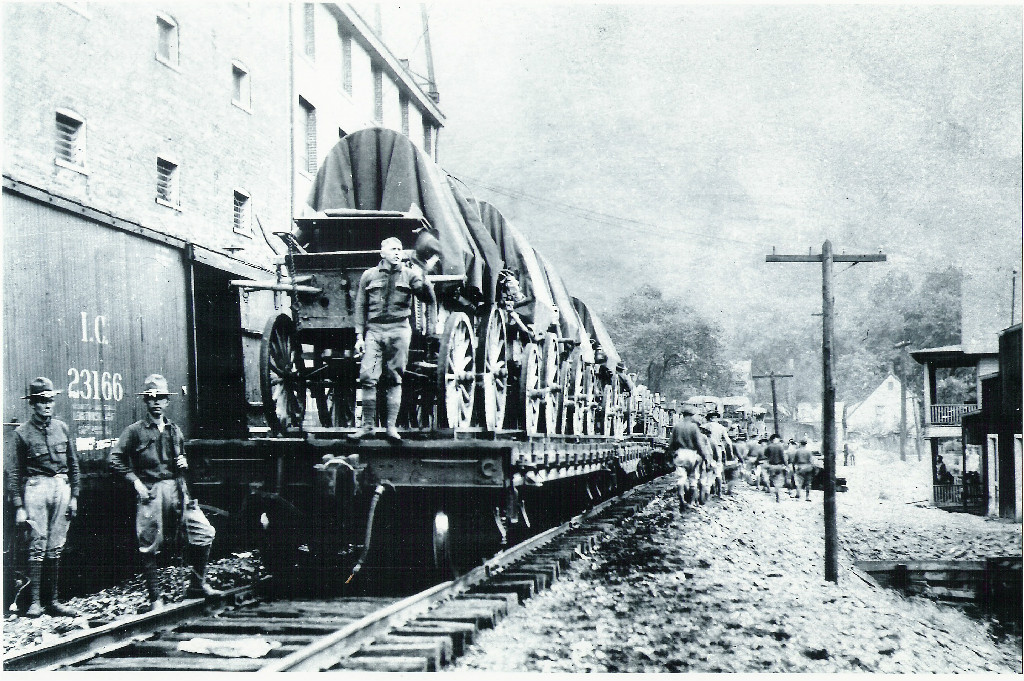 United States military arriving in Logan at the train station during the Mine Wars.