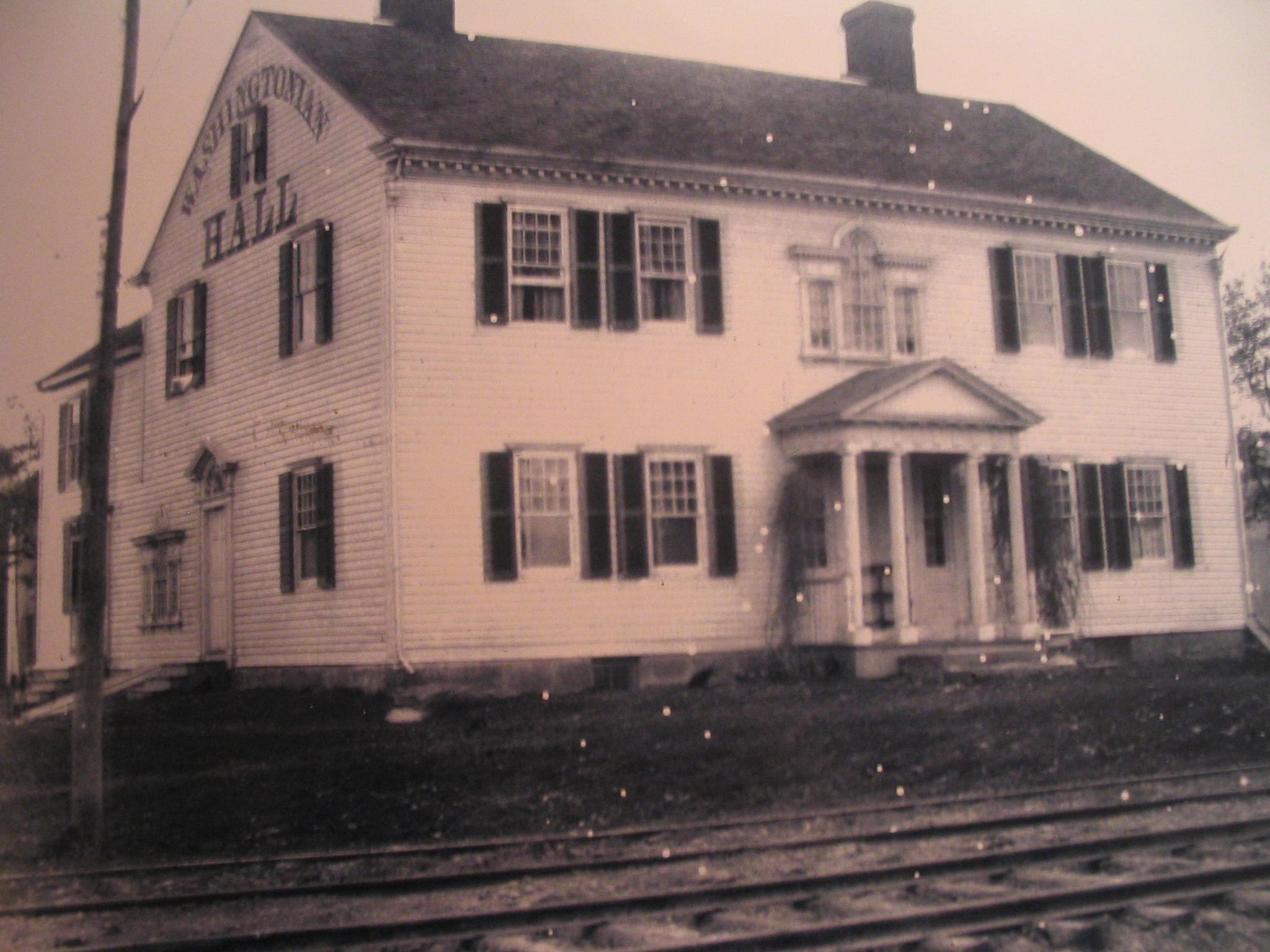Picture of Washingtonian Hall during the time period when it was used as a Temperance Inn and Trolly Stop