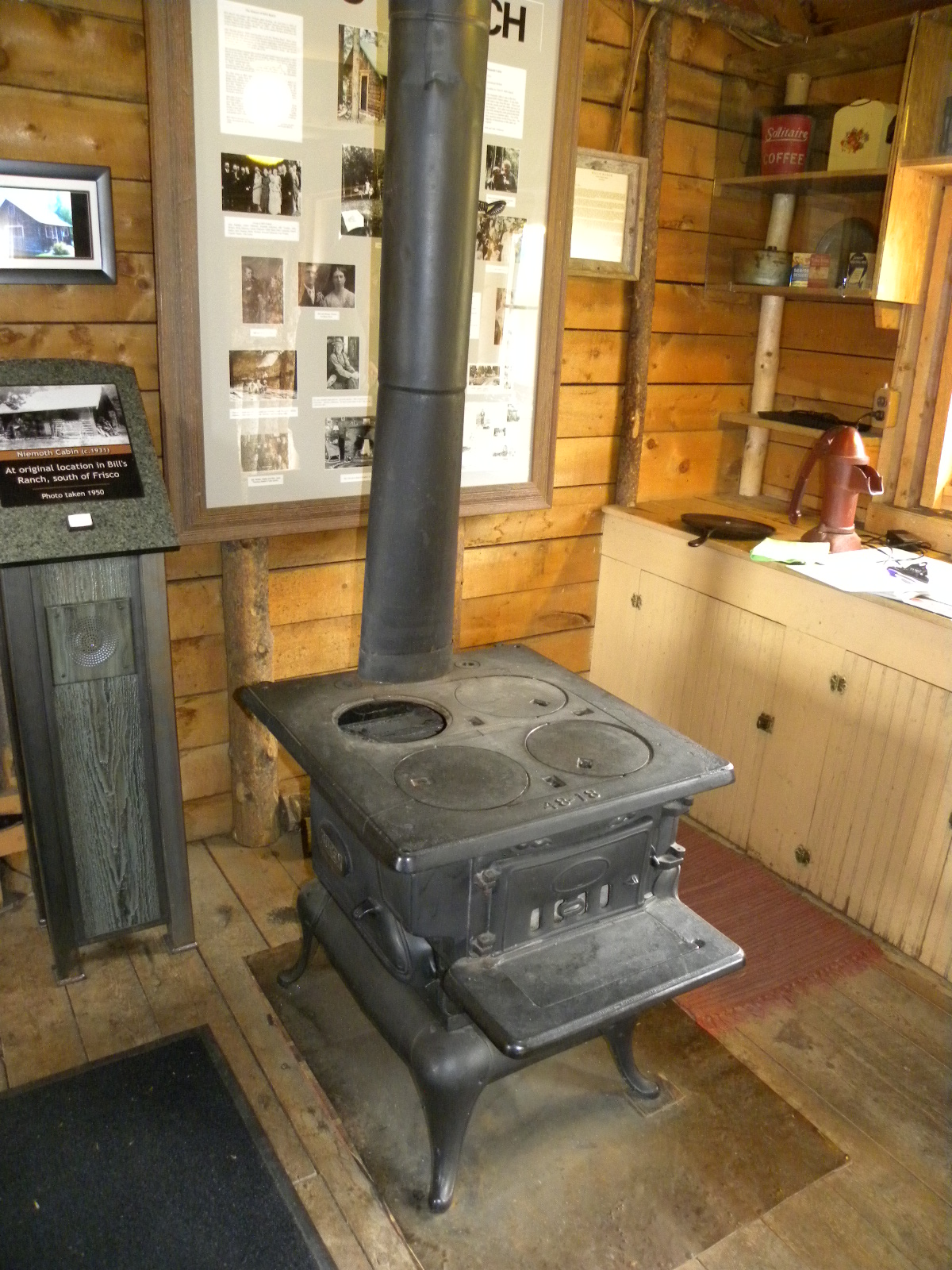 This cast iron wood burning stove used for cooking is one of two heat sources in the Niemoth Cabin; the fully functional fireplace was restored in the mid-80's once the cabin was moved to the Park.