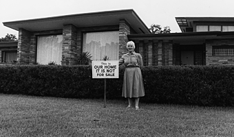 "In the 1960s some Whites who wanted the neighborhood to stabilize as an integrated neighborhood posted signs stating ""This Is Our Home It Is Not For Sale."""